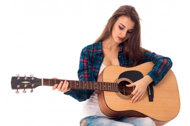 young brunette lady with guitar