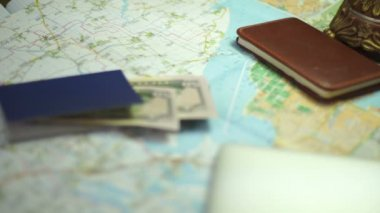 Girl notes vacation destination on the map