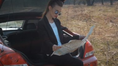 Girl in the trunk was studying a map of the area