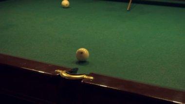 Men play Russian Billiards