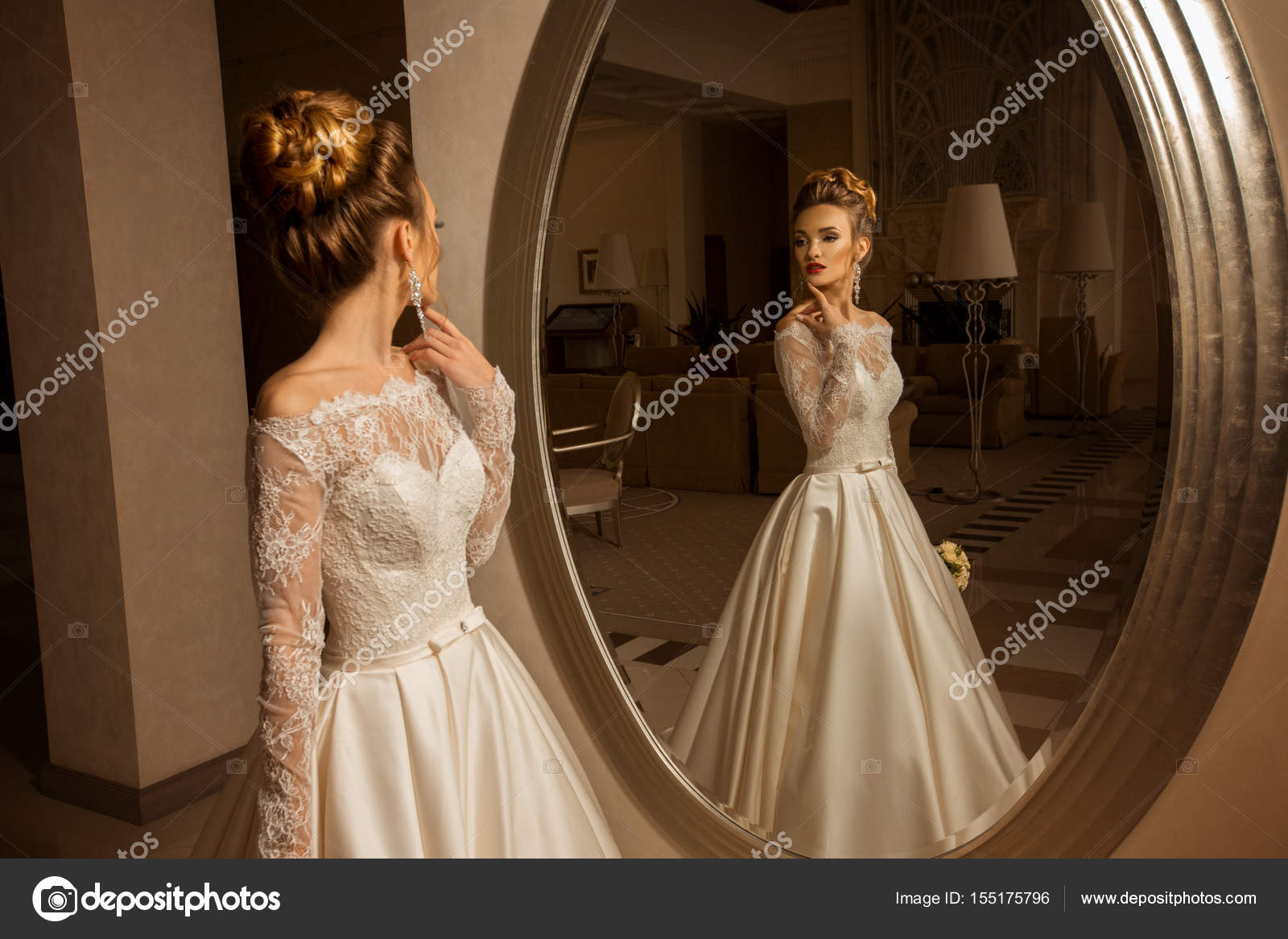 blonde bride in wedding dress looking at the mirror — Stock Photo ...