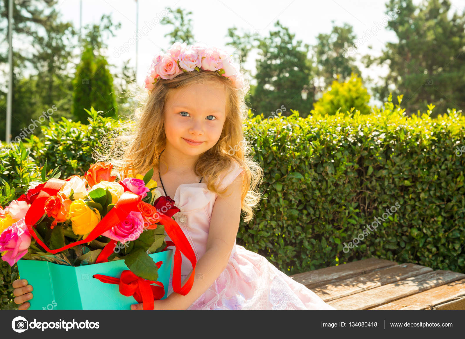 Adorable Little Child Girl With Bouquet Of Flowers On Happy Birthday