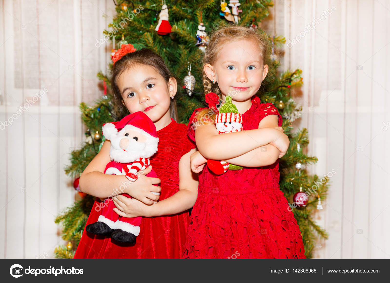 Portrait Of Two Children Girls Around A Christmas Tree Decorated Kid On Holiday New Year Stock Photo C Vitmarkov 142308966