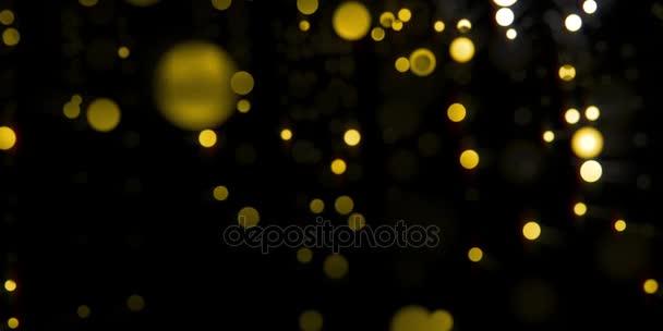 Zlatá, zlatá glamour světlo bokeh částice pohybu v černé noci, lze použít jako pozadí smyčky
