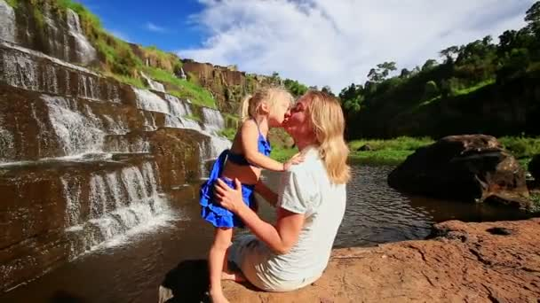 mother with daughter near waterfall of Pongour