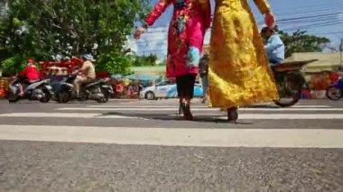 girls in long dresses cross street crossroad