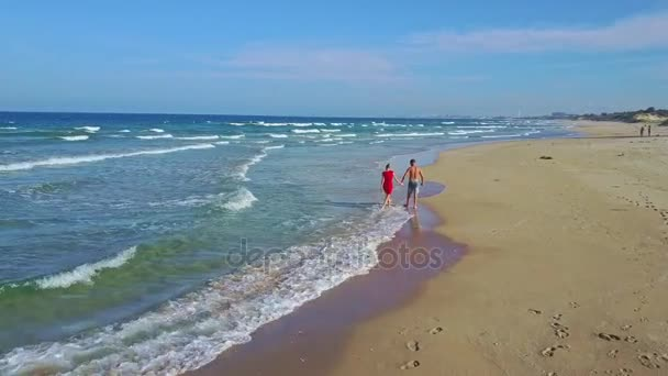couple hugging and kissing on ocean beach