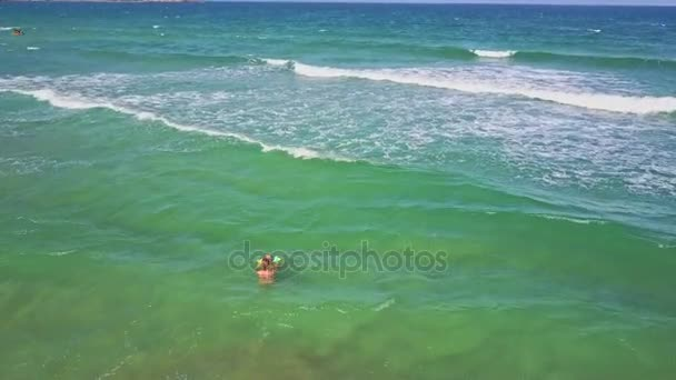 mom and girl swimming in ocean