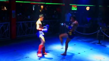 Thai boxers fight on ring in night club