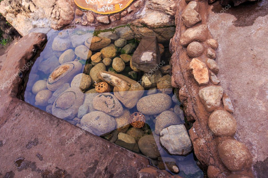 Stones under Transparent Water of Pond in Park