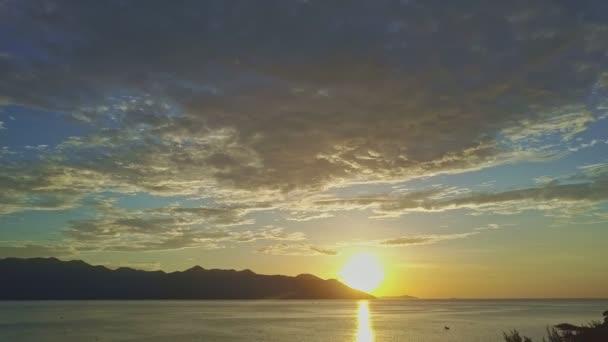 sunrise over tranquil ocean against distant hills