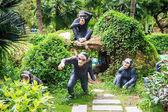 Funny Sculptures of Black Monkeys in Park