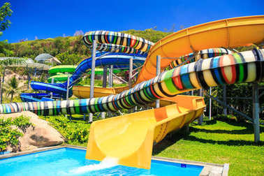 Colorful Water Slides Tubes in Tropical Aqua Park