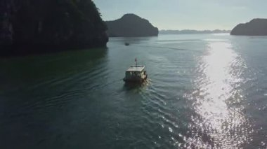 tourist boat sailing in tranquil bay