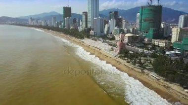 amazing panorama resort city seafront with hotel buildings on Yellow sea shore and beach after typhoon against mountains