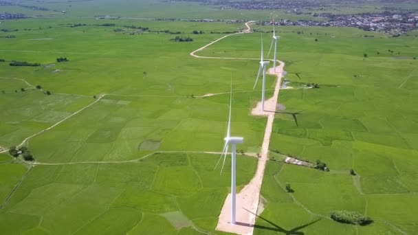 Upper view pictorial green rural landscape with wind generator towers on  ground road against distant hills
