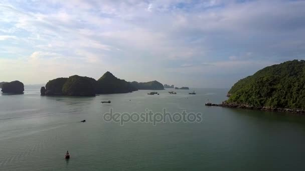 picturesque aerial view wide tranquil ocean bay and small rocky islands against sky with white clouds