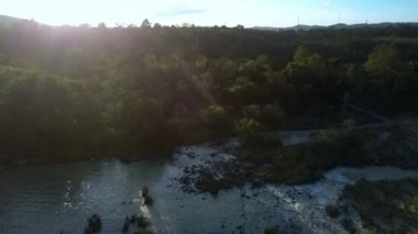 amazing aerial panorama wide tranquil river among deep tropical jungle against bright evening sun