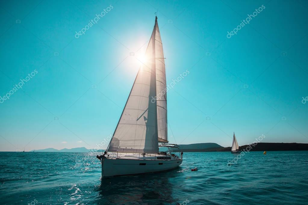 Sailing ship with white sails