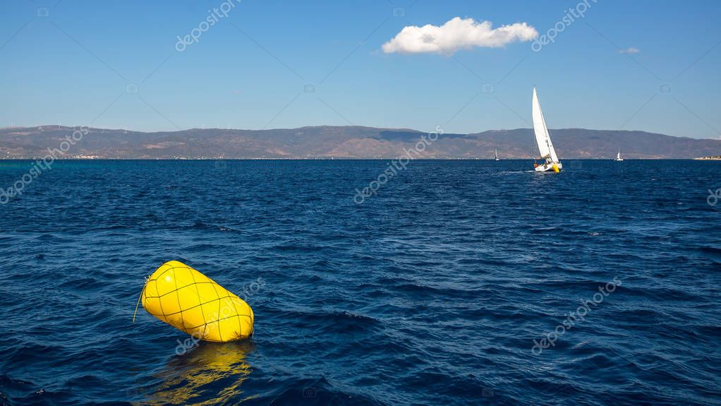 Finish line buoy at sailing yacht