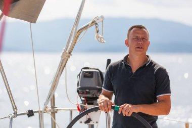 Skipper on sailing boat
