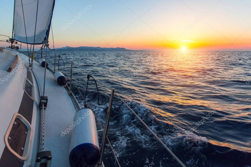 Luxury sailing yacht at sunset