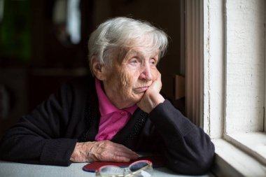 woman sadly looking out window