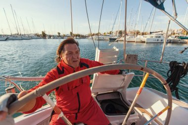 Man skipper at helm