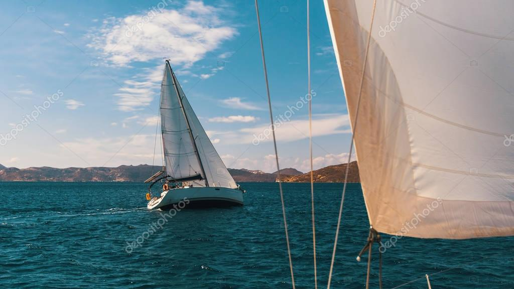 Sailors boats participate in sailing regatta