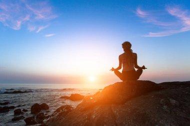 Meditation woman on the ocean