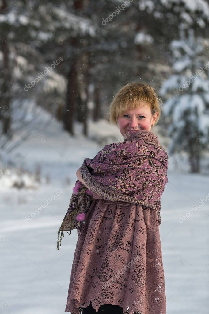 Young russian woman in the winter at snowy park.