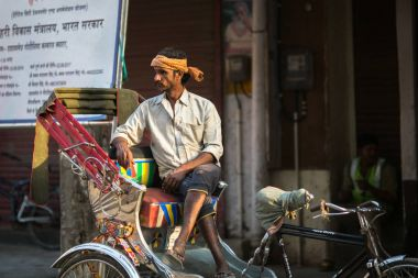 VARANASI, INDIA - MAR 23, 2018: Indian trishaw waiting passengers on the street. According to legends, the city was founded by God Shiva about 5000 years ago.