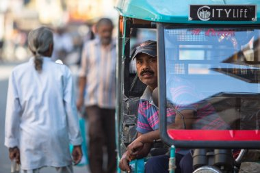 VARANASI, INDIA - MAR 21, 2018: Indian trishaw waiting passengers on the street. According to legends, the city was founded by God Shiva about 5000 years ago.