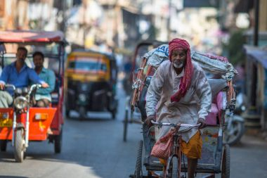VARANASI, INDIA - MAR 21, 2018: Indian trishaw on the street. According to legends, the city was founded by God Shiva about 5000 years ago.