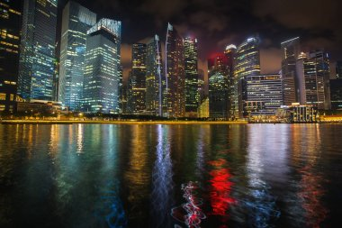 View of the business district Marina Bay at night in Singapore.