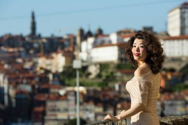 Mixed-race asian woman on a street in old Porto downtown. Multicultural Portugal.