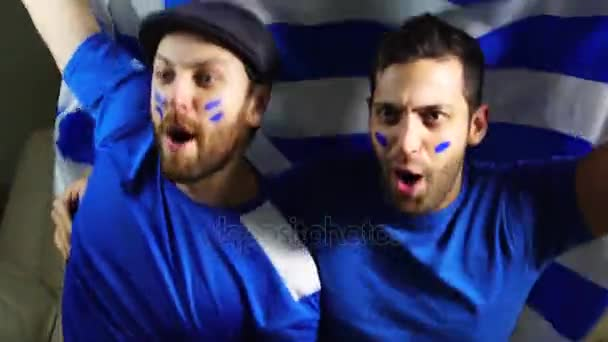 Uruguaiano fan che tiene la bandiera nazionale