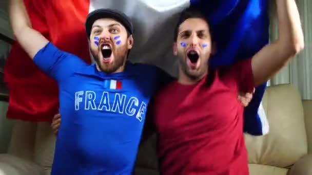 Francouzský fanoušci drží státní vlajka