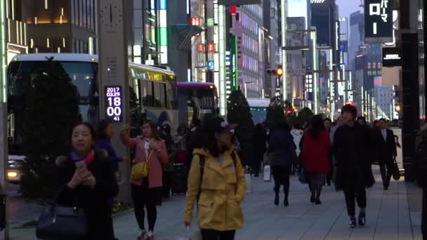 TOKYO, JAPAN - CIRCA MARCH 2017: people walking in famous Ginza district in Tokyo, Japan. Ginza is recognized as one of the most luxurious shopping districts in world, with many flagship luxury brand stores located here.