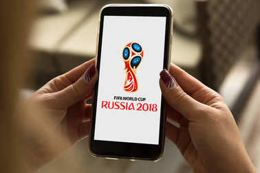 Woman using her mobile with the Russia 2018 logo