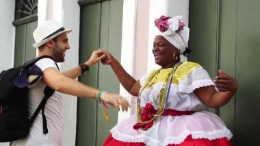 Tourist dancing with local Brazilian woman