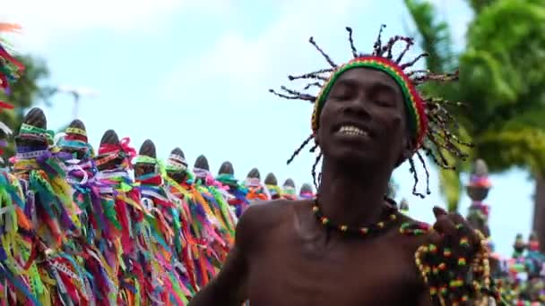 Afro dancing around the a colorful ribbons