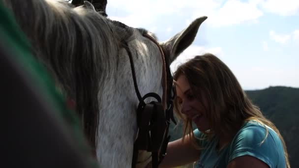 Woman taking care of her horse