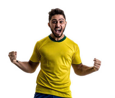 excited sportsman in yellow Brazilian uniform celebrating on white background. Isolated view of cheerful male fan