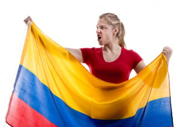 Soccer woman holding flag of Colombia isolated on white background