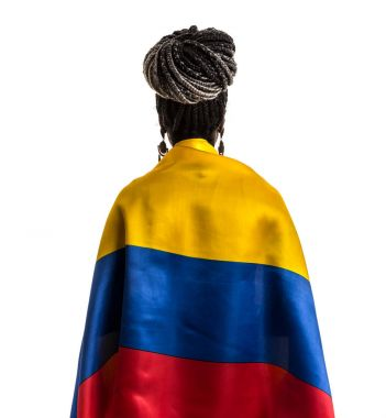 afro female fan celebrating with flag of Colombia on white background
