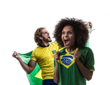 young woman and man football fans with brazilian flag