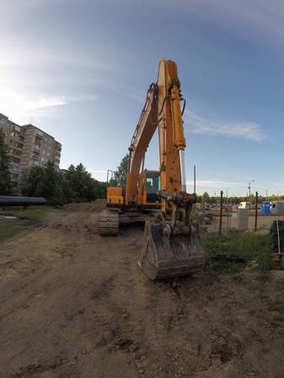 Yellow excavator in the construction site