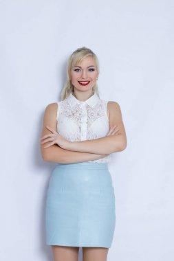 Blonde woman in blue skirt