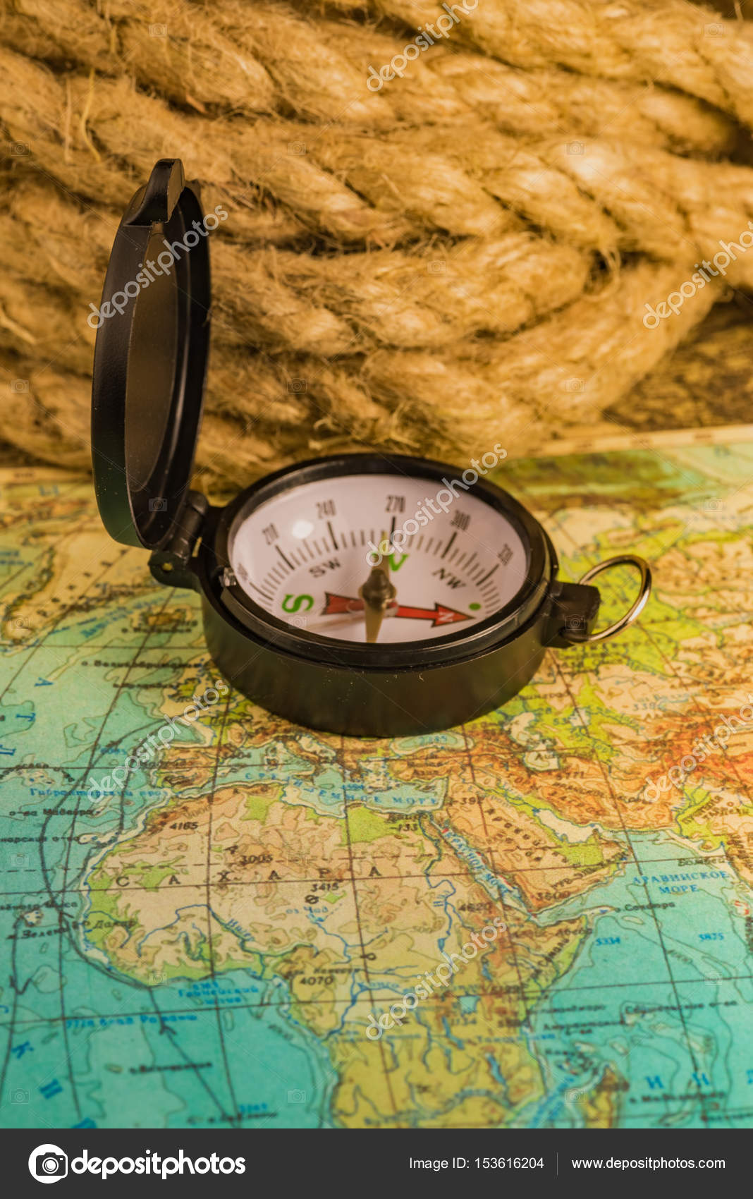 Compass on the world map stock photo db rus 153616204 compass lies on an ancient world map photo by db rus gumiabroncs Gallery